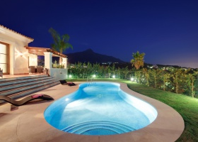 Pool by night of modern villa for sale at Nueva Andalucia Marbella
